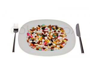 1203449-many-different-tablets-and-medicines-are-on-plate[1]